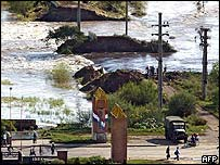 Waters begin to recede after a dyke is dynamited by engineers in Santa Fe, Argentina