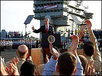 George W Bush gives a thumbs up to the crew of the USS Abraham Lincoln