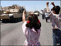 Iraqi children jeer US troops in tank in Falluja, Iraq