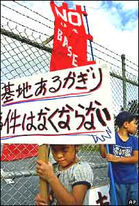 Children join a peaceful demonstration outside Kadena Air Base at Chatan in Okinawa