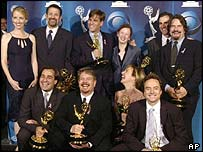 The West Wing cast and crew including Thomas Schlamme and Aaron Sorkin (top row, second and third left)