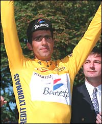 Miguel Indurain celebrates winning the 1995 Tour de France, where he claimed his fifth victory in the race