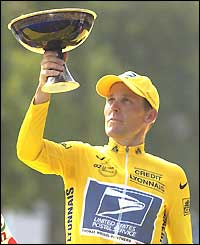 Lance Armstrong celebrates winning his fourth Tour de France title in 2002