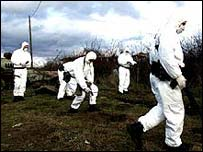 Radioactive experts in protective suits