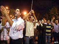 Iranian students chant during an overnight anti-government demonstration outside the Tehran University on 13 June 2003