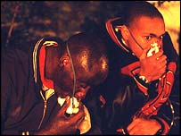 Rescue workers use oxygen masks in the wake of the fictional air crash