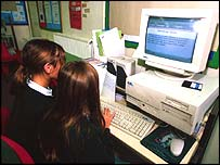 Girls sitting at a computer in the classroom