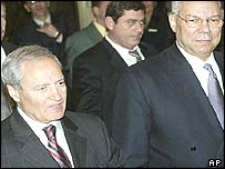 Syrian Foreign Minister Farouq al-Sharaa greets Colin Powell