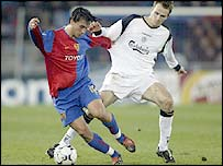 Hakan Yakin (left) flees from the attention of Liverpool's Dietmar Hamann
