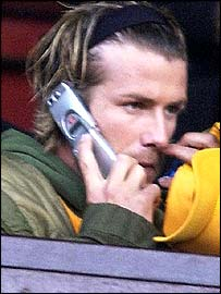 David Beckham speaks on his mobile phone