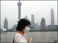 A tourist in Shanghai takes protections against the Sars virus