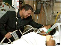 King Abdullah II of Jordan visits a Jordanian police officer who was injured at Queen Alia International airport near Amman
