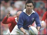 Richie Collins tries to pick holes in the Welsh defence