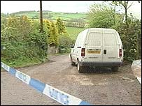 A police van at the search site in Devon