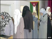 Jordanian women queue to vote at a polling station
