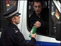 Policeman examines fire extinguisher