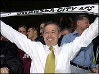 Swansea director of football Brian Flynn celebrates his side's final day survival