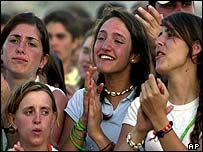 Young people listen to Pope John Paul II at the Cuatro Vientos air base in western Madrid