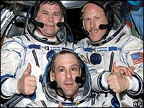 Donald Pettit, front, Kenneth Bowersox, rear right, and Russian cosmonaut Nikolai Budarin , rear left