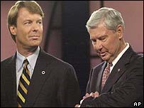 Presidential hopeful Bob Graham checks his watch (right) as John Edwards looks on at the ABC debate