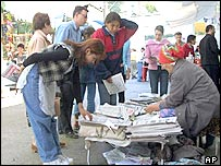 People buying papers in Uzbekistan