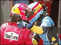 Michael Schumacher congratulates Fernando Alonso after the Spanish Grand Prix