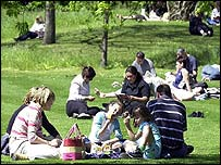 People enjoy the sunshine in a park