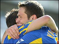 Mark Viduka (right) and Harry Kewell celebrate at Highbury
