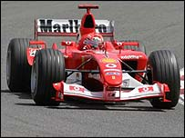 Michael Schumacher steers the new Ferrari to victory
