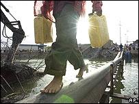 Boy carries water in Basra