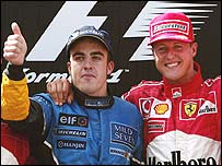 Fernando Alonso on the podium with Michael Schumacher