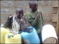 Children with water cans in Nairobi