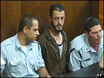 Nasser Awais in court, flanked by Israeli police