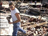 Resident picks his way through the rubble in Pierce City
