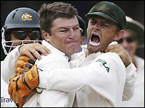 MacGill and Gilchrist celebrate the dismissal of Sarwan