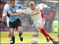 Barry Robson (right) in action for Caley Thistle