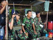 Armed Indonesian soldiers guard a mountain area in Lamno village, Aceh