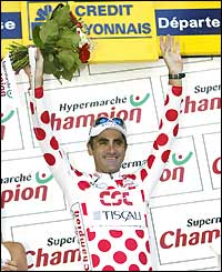 Laurent Jalabert stands on the podium wearing the polka dot jersey after being crowned king of the mountains after stage 18