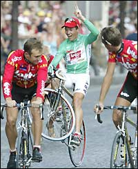 Robbie McEwen of Australia does a wheelie after winning the best sprinter title