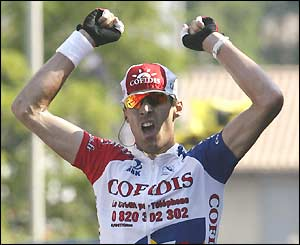 David Millar, Cofidis' British rider, celebrates as he crosses the line to win stage 13