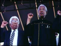 Former South African President Nelson Mandela (right) and Walter Sisulu at an ANV rally in Durban