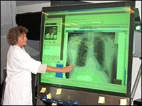 Doctor with large screen