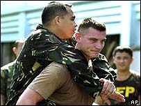 An American soldier gives a ride to a Filipino soldier during joint training exercises