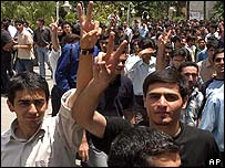 Iranian students give the victory sign during a demonstration in Tehran