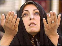 A Shia woman prays in the holy city of Najaf