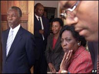 South African President Thabo Mbeki, left, with his wife Zanele outside the house of Walter Sisulu
