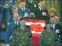 Pallbearers carry coffin of one of the Canadian soldiers killed in the incident