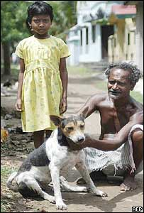 An Indian villager poses with his dog and Karnamoni Ha