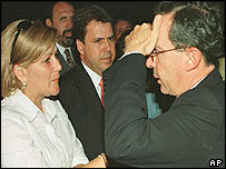 President Alvaro Uribe with the widow of Governor Gaviria