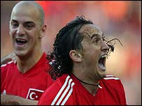 Tuncay Sanli (right) celebrates his winning goal